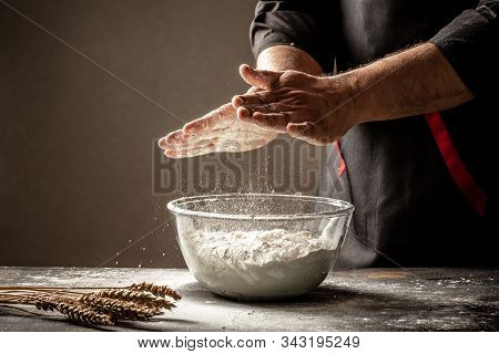 Photo Of Flour And Men Hands With Flour. Cooking Bread. Kneading The Dough. Isolated On Dark Backgro