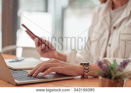 Cropped Shot Of Asian Accountant Woman Working On Desk Office And Drinking A Coffee.asian Woman Work