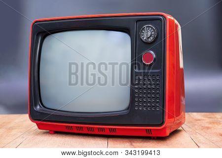 Retro Old Tv Screen Receiver On Wooden Desk . Classic Vintage Retro Style.