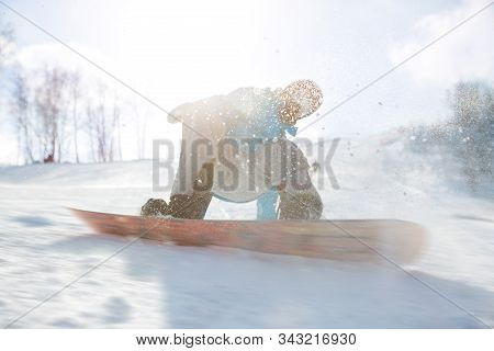 Snowboarder Is Jumping With Snowboard From Snowhill Snowboarder Balances When Lands After Fly On Sno