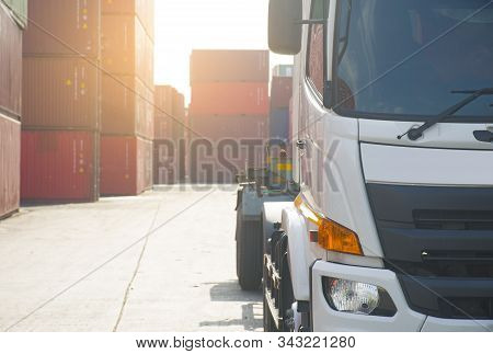 Head Of Haulage Truck With Container Depot At The Background As For Industry, Transportation And Log