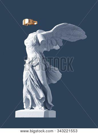 3d Model Of Winged Victory And Golden Vr Glasses On Blue Background. 3d Illustration.