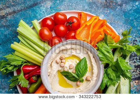 Hummus Platter With Assorted Snacks. Hummus In Bowl And Vegetables Sticks. Plate With Middle Eastern