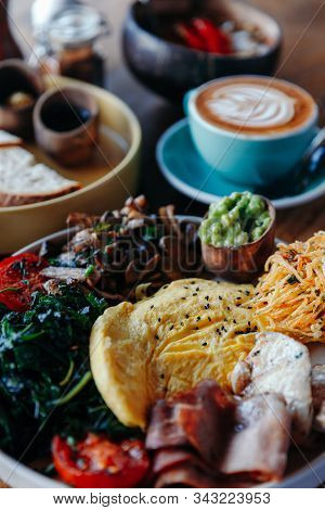 Morning Breakfast On A Table, Waffles With Cream, Berries, Coffee, Cappuccino, Bowl, Omlet With Vege