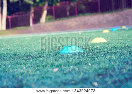 Football Chips For Training On Artificial Turf Close Up.