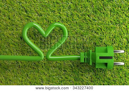 Green Power Cord With Heart Shaped Power Cable On Grass Background With Copy Space - Eco Or Green Po