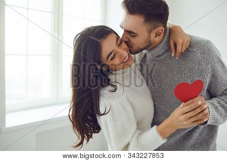 Valentines Day. Couple Gives Heart To The Valentines Day In The Room.