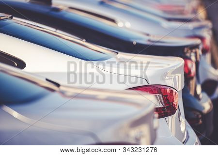New Colorful Cars In A Row. Dealership Sales Lot. Closeup Photo. Transportation Industry.