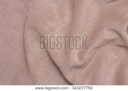 Background Texture Of Faux Suede Closeup. Faux Brown Suede By The Waves. Close Up