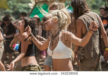 Riomalo De Abajo, Extremadura, Spain - July 16, 2018: A Young Woman Dances On The Front Row Of The M