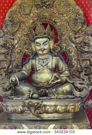 A Bodhisattva Sculpture Inside Of A Temple Seen In In Singapore