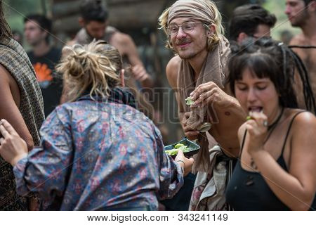 Riomalo De Abajo, Extremadura, Spain - July 16, 2018: A Woman Distributes Lime Slices Among The Peop
