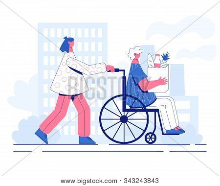 Volunteer Help Disabled. Woman In A Wheelchair.