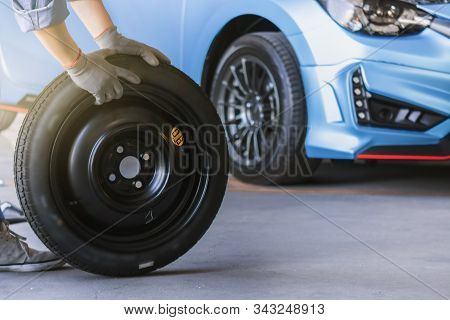 Asian Man Car Inspection Measure Quantity Inflated Rubber Tires Car.closeup Hand Holding Tire And Bl