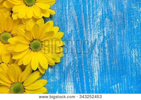 Flowers Over Painted Wooden Table. Flowers Background For Text. Floral Background, Flower Border. Bl