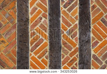 Vintage Brick Wall Typical English Masonry Background With Wooden Logs