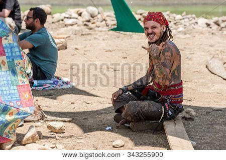 Riomalo De Abajo, Extremadura, Spain - July 15, 2018: A Very Tattooed And Pirate Scarf On His Head L
