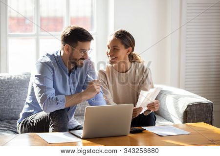 Happy Young Couple Pay Bills Using Online Banking