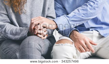 Support Gesture. Man Holding Hand Of Stressed Woman At Rehab Meeting, Panorama