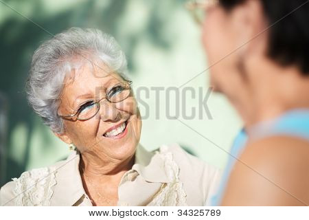 Old Friends, Two Happy Senior Women Talking In Park