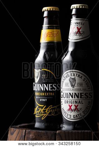 London, Uk - April 27, 2018: Bottle Of Guinness Original And Draught Stout Beer On Top Of Old Wooden