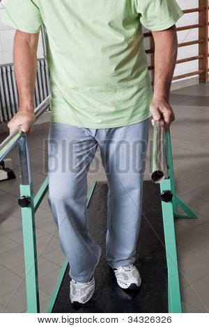 Portrait of Senior man having ambulatory therapy.