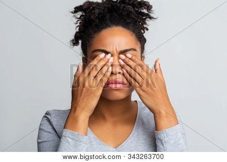 African Girl Rubs Her Eyes, Suffering From Conjunctivitis, Ocular Diseases Concept
