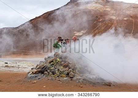 Myvatn, Iceland - Sept 11, 2019: Tourist Taking Photo At Namafjall Geyser,  Its A Geothermal Area Lo