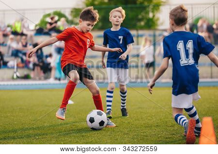 Young Boys Playing Soccer Game. Training And Football Match Between Youth Soccer Teams. Junior Compe