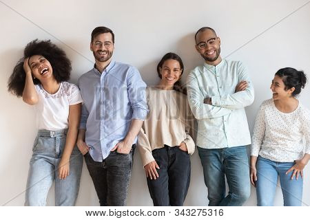 Overjoyed Multiracial Young People Posing For Group Picture