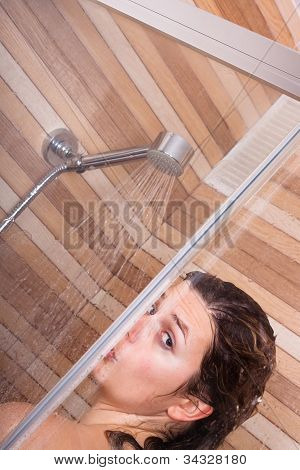 Close up of young woman having shower. poster