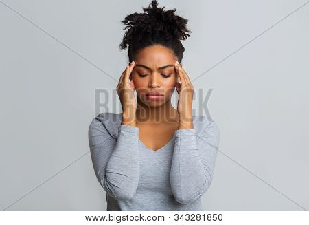 Young Upset Afro Girl Having Headache, Massaging Her Temples, Migraine Concept, Copy Space
