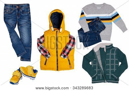 Collage Set Of Children Clothes. Denim Jeans Or Pants, A Pair Shoes , A Yellow Down Vest With Shirt,