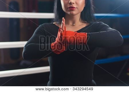 Boxer Woman Hands With Red Boxing Wraps In The Boxing Ring. Close-up Shot. Closeup Hands Of Female F