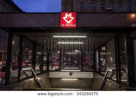 Prague, Czechia - November 2, 2019: Sign With The Logo Of Prague Metro (prazske Metro) In Front Of T
