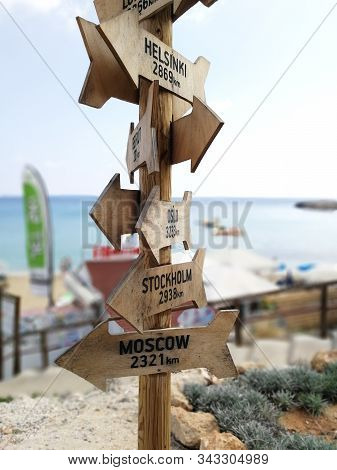 Wooden Route Pointer Showing Way To The Different Cities Of The World. Wooden Signpost To Moscow, St
