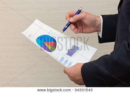 Business Man Reviewing A Document