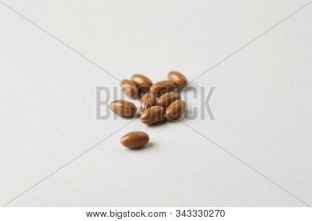 Vitamin K2 Tablets On Bright Paper Background. Close Up. Copy Space.