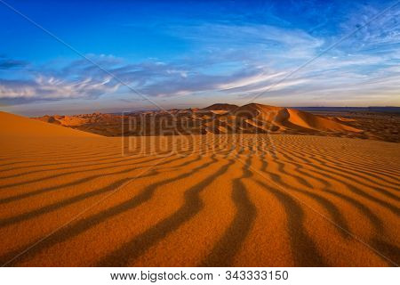 Desert Landscape Near Merzouga, Small Village In Morocco, Known For Its Proximity To Erg Chebbi, Tou