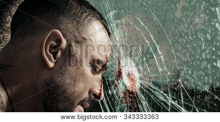Destroy Obstacles. Handsome Brutal Man Near Broken Glass. Brutal Handsome Macho Focused On Fight Res