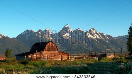 Shot Of A Barn And Grand Teton At Sunrise In Wyoming