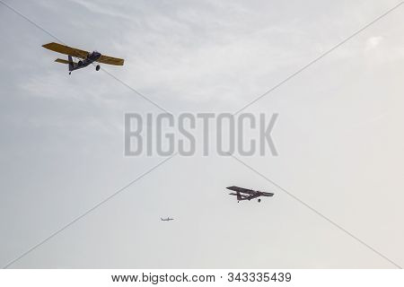 Tel Aviv, Israel - April 13, 2019: Ultralight Airplanes Flying Over The City During A Sunny Evening.