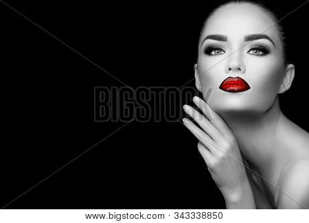 Beauty glamour Fashion brunette model girl black and white portrait. Gorgeous Sexy woman with perfect trendy makeup, face contouring, gradient red lips. Beauty trends. Isolated on black background.