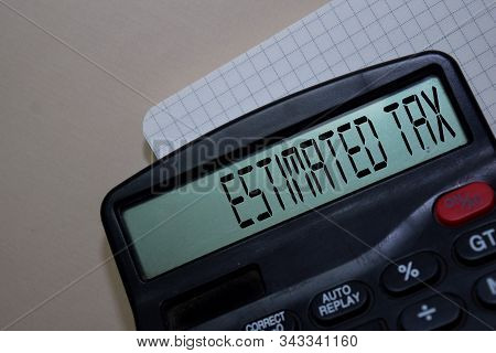 Estimated Tax Write On The Calculator On Office Desk.