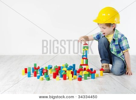 Kids Play Room, Child in Hard Hat Playing Building Blocks Toys