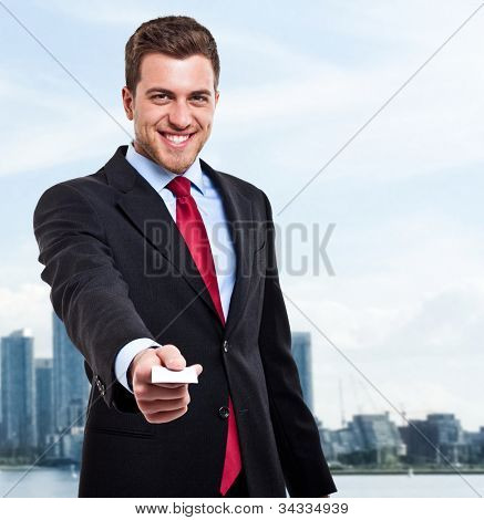 Portrait of a businessman giving you a business card