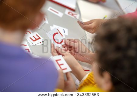 Schoolchildren learning foreign languages during the lesson poster