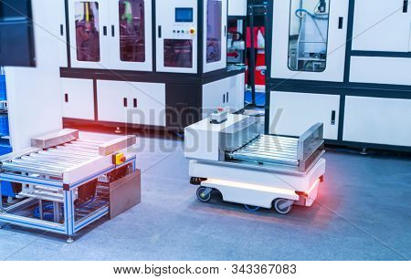 warehouse robot car carries cardboard box assembly in factory