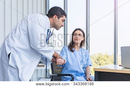Doctor Check-up Pregnant Patient Pulse Pressure By Hands At Hospital Or Medical Clinic, Health Care