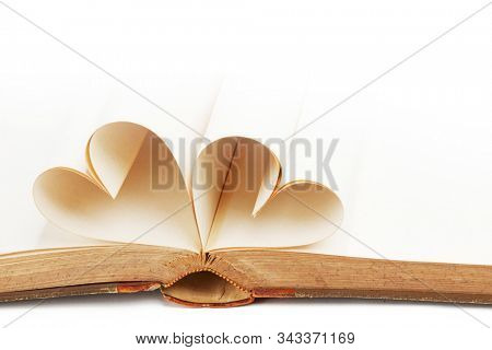 Heart made of blank book pages, love reading, Valentines day concept